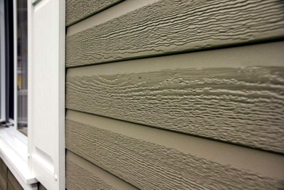 Steel Log Siding — seamless steel PVC coated color custom curved log wood grain siding that requires zero maintenance and protects against bugs, insects and critters.